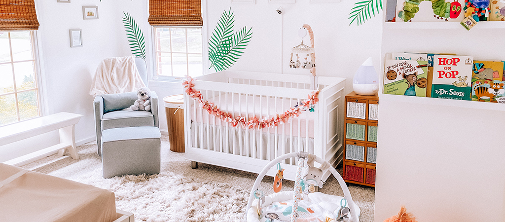 Jungle vibes with a tropical rainforest-themed nursery